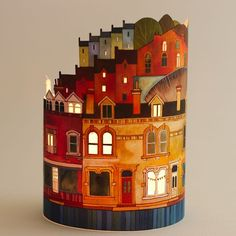 Paper Bunting Lantern by Kate Lycett, a artist from Hebden Bridge, UK, who paints landscapes & townscapes. Her lanterns are stitched paintings of the town, printed & lasercut with great detail / http://www.katelycett.co.uk/portfolio/#