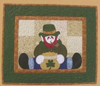 "Straddling Leprechaun Applique Pattern by The Wooden Bear at KayeWood.com. Way cute leprechaun straddles a bowl of gold coins with a clover symbol on it. Finished size approximately 19.5"" x 23.5"" http://www.kayewood.com/item/Straddling_Leprechaun_Pattern/1202 $8.00"