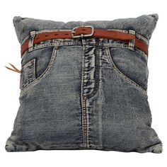 Reclaimed denim pillow with a jeans-inspired design.   Product: PillowConstruction Material: Reclaimed denim and fil...