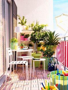 Apartment patio idea - bright colors/white furniture