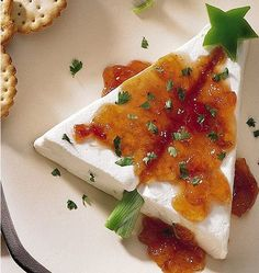 Cream cheese and pepper jelly Christmas tree appetizer - how clever! Cut a cream cheese block on the diagonal to have the pieces to make a tree shape, then add some bell pepper decorations and some pepper jelly, and serve with Wheat Thins. Christmas Tree Food, Christmas Cooking, Christmas Goodies, Christmas Treats, Holiday Treats, Holiday Fun, Holiday Recipes, Christmas Holidays, Christmas Eve Appetizers