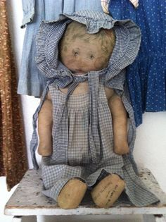 Early Mills Doll in early Blue and white homespun..