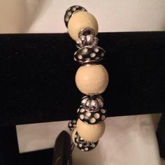 Bracelet Slide bracelet:  tan leather beads, carved bone bead, silver plate rondelle spacers on silver plate bracelet with lock.  0941B.                                  Quantity:  2 Jewelry Bracelets