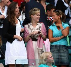 Kate wore a pretty white sundress with a cardigan to the Wimbledon tennis championships. via StyleList