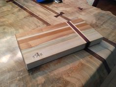 Maple, poplar, cherry with walnut accent edge grain cutting board