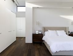bedroom with dark hardwood floors | Light Or Dark Wood Flooring - Which One Suits Your Home?