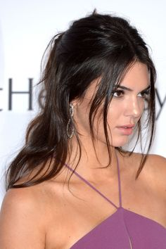 Kendall Jenner wore this cool 'do on the red carpet. But in real life, it's the perfect look for a morning when you've hit snooze one too many times. It looks special, but it's effortless. To work her look: Part your hair down the center and gather two thick sections from each side of your part at your hairline. Pull each section back and secure it in the center of the back of your head in a small messy bun. Tame flyways around your hairline with a light-hold hairspray. (Try Dove Style…