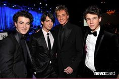 Kevin Jonas, Joe Jonas, Barry Manilow and Nick Jonas attend the 2009 GRAMMY Salute To Industry Icons honoring Clive Davis at the Beverly Hilton Hotel on February 7, 2009 in Beverly Hills, California.  (Photo by Lester Cohen/WireImage)