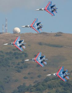 Sukhoi of the Russian Knights display team over the foothills of the Caucasus (Photo by Fyodor Borisov/Transport-Photo Images) Russian Jet, Russian Plane, Military Helicopter, Military Aircraft, Air Fighter, Fighter Jets, Military Shows, Air Machine, Aerial Acrobatics