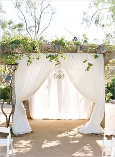 Fabric drapped wedding arbor @weddingchicks