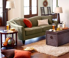 Green Couch Neutral White Wall With Warm Tones Accents
