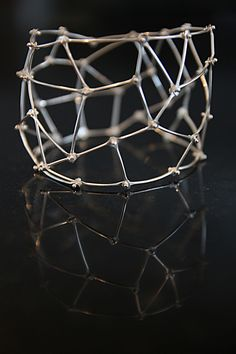 """Mirrored"" bracelet by Kristine Bolhuis, 2011 http://www.snagmetalsmith.org/members/kristinebolhuis/"