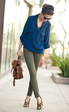 Beautiful business casual outfit - olive green ankle pants with cobalt blue pockets blouse, subtle leopard heels, brown satchel
