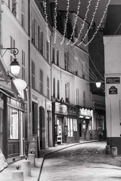 Winter Night, Rue Norvins    Twinkle lights are part of the festive season all over Paris, as seen here on Rue