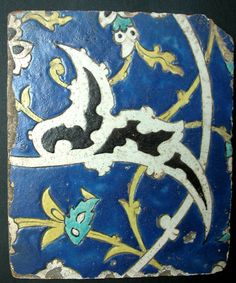 Cuerda seca ceramic tile, first half of the XVIIth century. This tile is decorated with an arabesque, flowers and branches on a cobalt background.    Persia, Safavid dynasty, first half XVIIth century, 19,5 by 23cm.