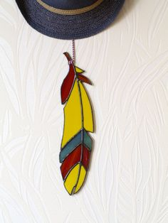 Glass suncatcher feather yellow opaque for wall decor by caracoja