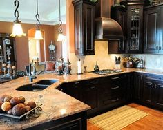 love the dark cabinets and a sink facing the open living room would be nice.