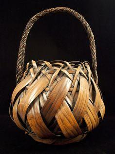 "Ikebana basket, Japan. Split fumed bamboo, tin liner. Meiji/Taisho Period. 56.5 "" (143.5 cm) circumference and 25"" (83.5 cm) high. #8221   $4500"