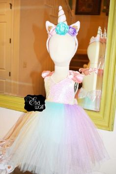 Tulle halter top dress with sequence and ruffled satin straps. Unicorn horn headband is sold separately. Unicorn magic bottle party favors can be found using this link : https://elsa-wolf-clothing-accessories.myshopify.com/collections/invitations/products/unicorn-magic-bottle-party-favors