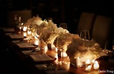Love the white flowers with the candles