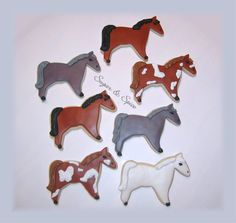 These were made for the same girl I had made the horse cake for. She is riding in her very first horse competition, and her mom ordered these for her to share with the other riders. Veronica picked the colors of the horses she wanted me to make. NFSC with RBC and royal accents. Thanks for looking!