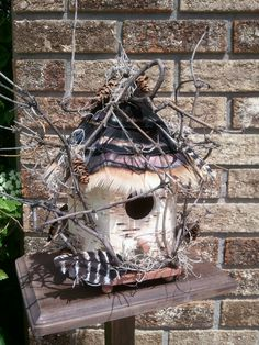 turkey feathers and spruce cone birdhouse