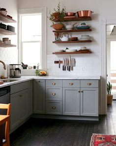 displaying dishes and pots/pans saves space and money; cheaper to buy single exposed shelves than full cabinets