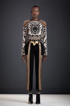Black and Gold Lion Jacquard Sweater 								Metallic Chevron / Double Face Paneled Pant 								Vintage Belt by Christopher Ross 								Mesa Boot