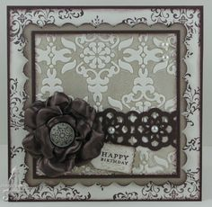 """Stamps: S/U's Tiny Tags, Bliss (R), Vintage Labels (R)  Card: Chocolate Chip, Very Vanilla, Crumb Cake  Ink: Crumb Cake, Chocolate Chip  Finishing Touches: 15/16"""" Chocolate Chip Satin Ribbon, Antique Brad, Pearls  Tools: Big Shot, Sizzix Vintage Wallpaper EB Folder, Sizzix Bigz Clear Large Scallop Square Die, Brayer, 1 3/8"""" Circle Punch, Sticky Strip, Lace Ribbon Border Punch, Dble Sided Tape, Dimensionals, Sponge, Mat Pack and Paper Piercing Tool,"""