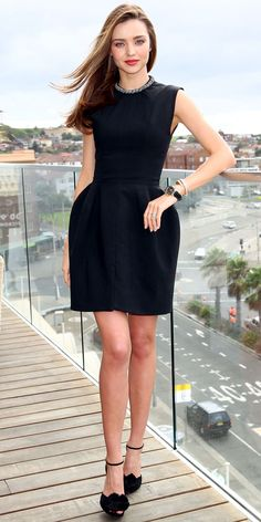 Miranda Kerr in a jeweled LBD and black ankle-strap heels.