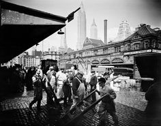 The Fulton Fish Market was a huge part of daily life in the late 18th century and early 19th century in New York City. The focus on maritime trade helped the economy and many people create jobs and flourish in their businesses. Eventually stands sold more than just fish, like sausage and vegetables, to the many, many customers. This is a picture of dock workers loading and unloading the ships that came to the South Street Seaport.