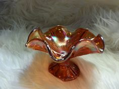 This beautiful carnival glass footed candy dish looks big in picture. Measurements:  3 1/2 tall by 5 1/4 wide. $13.50