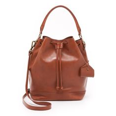 "Madewell Lafayette Bucket Drawstring Bag Gorgeous shoulder bag in genuine leather, by Madewell! Love the warm cognac color ( English saddle ). Carried for a short time, minor signs of wear mostly at bottom corners. Clean interior, comes with crossbody / shoulder strap. Perfect for spring and summer!  11 1/5"" x 15"" x 8 7/10"" Madewell Bags Shoulder Bags"