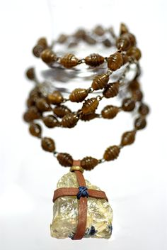 leather wrapped quartz with horn beads