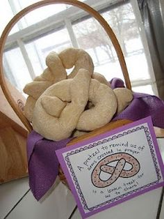 Pretzels for Lent - Did you know that the pretzel is a traditional food for lent? When early Christians would pray, they would cross their arms and touch each shoulder with the opposite hand. They also fasted very strictly during lent, making their bread with only water, flour, and salt. A monk shaped this in the form of praying arms for children, and the pretzel was born!