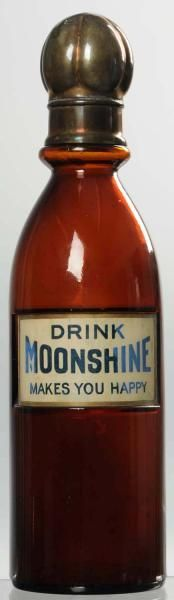 "Moonshine Label Under Glass Syrup Bottle. 1915 to 1920. Hard to determine if label is paper or reverse painted. Appears to have been off and some closed cracks or tears are evident under glass. Also, a few letters are lighter than the others. Still displays well. Condition (Very Good). Size 12 - 1/2"" T.  Estimate:	 350.00 - 700.00 Mar2013"