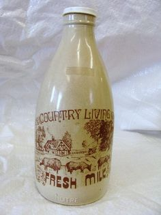 """Bottles - %%WOW%% """"COUNTRY LIVING FRESH MILK""""%%%GLASS MILK BOTTLE1 LITRE colorMOTTLED CREAM BROWN PLASTIC CAP was listed for R59.00 on 19 Mar at 21:02 by ecnettle12 in East London (ID:140147556)"""