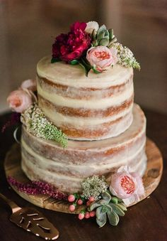 Two tier semi naked wedding cake covered in white chocolate ganache cake by Lilly Roses Cakes. View more on Instagram @lillyrosescakes
