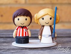 Football player and Leia in Jedi hood wedding cake topper  https://www.facebook.com/genefyplayground