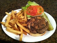 "Celebrate ""National Hamburger Month"" with our Village Burger, a 10oz ground chuck burger topped with a mushroom Bordelaise sauce."