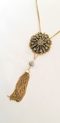 Gorgeous long gold statement necklace, with vintage brooch up cycled, gold tassel, and a lovely silver bead. This necklace would be great to dress up your bluejeans, or where at a fabulous holiday party. https://www.etsy.com/listing/544431102/long-gold-statement-necklace-with-1960s