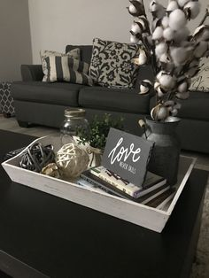 49 Smart Farmhouse Coffee Table Decor Ideas To Try - The farmhouse gives you a sense of home and family. It is full of activity, especially around the table. They say old is gold, a reason you should mak. Coffee Table Decor Living Room, Center Table Living Room, Decorating Coffee Tables, Coffee Table Tray Decor, Coffee Table Centerpieces, Shower Centerpieces, Wedding Centerpieces, Ottoman Decor, Diy Ottoman