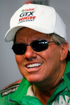 John Force Photos Photos - John Force, driver of the Castrol GTX High Mileage funny car answer questions from the media after failing to qualify for the NHRA Carolinas Nationals at the Zmax Dragway on September 13, 2008 in Concord, North Carolina. - NHRA Carolinas Nationals Day 2