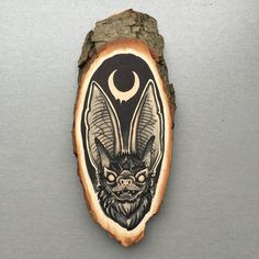 Wood slice with an original drawing of a long eared bat - on etsy by inkspirednl