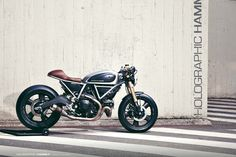 """We've been big fans of the work done by Holographic Hammer for a long, though we have only curious featured their work once before -- and that's a shame, since the French outfit is making some interesting concepts, both digitally and physically. We're therefore happy to share with you their latest work, the Ducati Scrambler """"Hero 01"""". Holographic Hammer tells us that they wanted to keep the purpose of the Scrambler at the Hero 01's core, namely a bike that you actual..."""