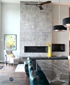 Contemporary 2 storey fireplace with modern tile, linear gas fireplace insert, floating hearth and modern fan. Quartz countertop is Ellesmere by Cambria. E-decor and Consultant Kylie M Interiors