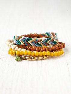 """Love the yellow one. Silver Lake Bead Bracelet  Style: 24338246  Pack of three beaded stretch bracelets and one woven friendship bracelet. Friendship bracelet has lobster claw clasp closure. Each bracelet is different from each other in this pack.     *8"""" circumference   $28.00"""