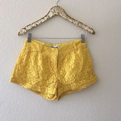 yellow lace shorts Not in a rush to sell these.. I absolutely love them I just don't get a chance to wear them very often.  perfect condition, fully lined cuffed lace shorts. Top is for sale too.. I can offer a bundle discount Francesca's Collections Shorts
