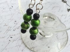 Black and green dangle earrings by OnTheWireByMaryJane on Etsy, $15.00