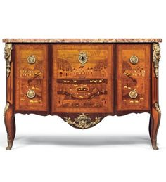 """A Louis XV Ormolu-mounted, Kingwood and Fruitwood Marquetry Commode by Andre-Louis Gilbert c. 1770. The Breche d'Alep marble top above two drawers. The front and sides decorated with figures, animals and birds in an architectural landscape, the apron centred by a male mask, on cabriole legs, stamped three times A.L.GILBERT and J.BIRCKLE. Height: 34"""" (86cms)  Width: 51"""" (130cms)  Depth: 24 ½"""" (62cms) Offered by ANTHONY OUTRED LTD £45,000"""